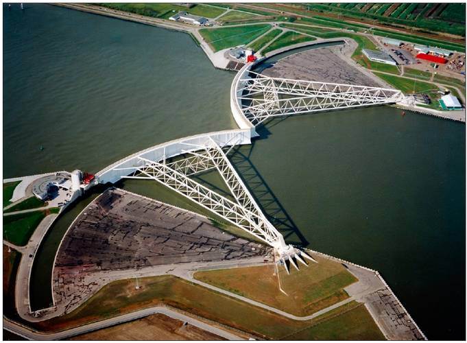 Figure 5. The Maeslant storm surge barrier near Rotterdam during a test closure (source: www.BeeldbankVenW.nl).