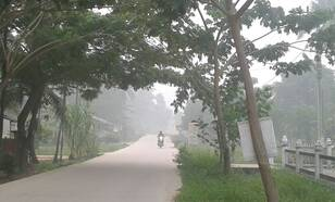 Smog in Indonesische straat in september 2015. Foto Meteorological Station in Pekanbaru, Agency for Meteorology Climatology and Geophysics