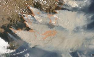 Bosbrandrook op 4 januari 2020 boven zuidoost-Australië zoals waargenomen met de het MODIS satellietinstrument of de NASA Aqua satelliet.