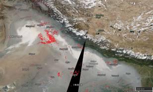 .Figuur 3: Actieve vuurhaarden en rook op 9 november 2017. (Bron: NASA)