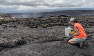Vulcanologist Elske de Zeeuw-van Dalfsen making a gravity measurement near the crater of Mt. Kilauea, Hawaii.